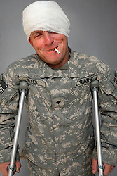 Specialist Daniel J. Allen, 29. Medic. Harper Woods, Michigan. Soldiers from Alpha Battery 3-321 Field Artillery in Afghanistan's eastern Khost Province at the Terezayi District Center near the Afghan-Pakistan border on Friday Oct. 17, 2008.