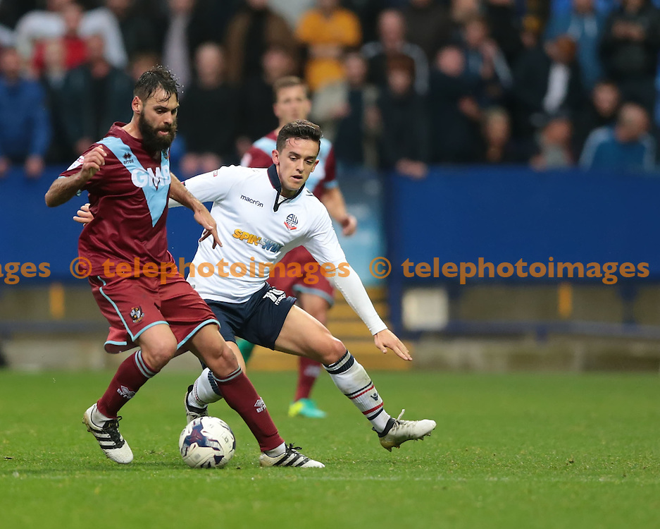 Port Vale midfielder Paulo Tavares (8) is challenged by Bolton Wanderers striker Zach Clough (10) during the Sky Bet League 1 match between Bolton Wanderers and Port Vale at the Macron Stadium in Bolton. October 29, 2016.<br /> Nigel Pitts-Drake / Telephoto Images<br /> +44 7967 642437