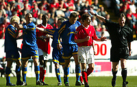 Photo: Scott Heavey<br />Charlton Athletic V Leeds Utd. 05/04/03<br />Despite the protests from Charltons Scott Parker, the ref Mr. E Wolstenholme gives Leeds the penalty during this FA Barclaycard Premiership match.