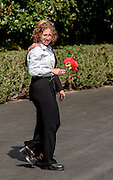 Chelsea Clinton holding a silk flower walks with her mother first lady Hillary Rodham Clinton to board Marine One helicopter on the South Lawn of the White House August 19, 1999 in Washington, DC. The Clinton's are traveling to Martha's Vineyard for a vacation.
