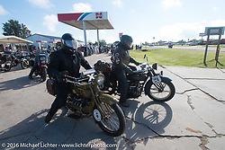 Jeff Tiernan riding his 1929 Henderson KJ with Kelly Modlin on his 1927 Henderson Deluxe pull out from the first gas stop during Stage 8 of the Motorcycle Cannonball Cross-Country Endurance Run, which on this day ran from Junction City, KS to Burlington, CO., USA. Saturday, September 13, 2014.  Photography ©2014 Michael Lichter.