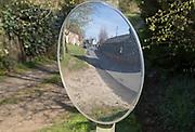 Convex mirror used for road view, Shottisham, Suffolk, England, UK