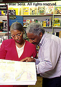 Active Aging Senior Citizens, Retired, Activities, Shopping. Elderly African American Couple Browse in Bookstore, Active Mind, Staying Young