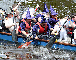 © Licensed to London News Pictures. 10/07/2016. York, UK.  Competitors take part in the York Rotary Annual Dragon Boat Challenge 2016. 36 teams battle it out on the River Ouse in York raising thousands of pounds for charity.  Photo credit: Anna Gowthorpe/LNP
