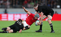 Wales' Jonathan Davies is tackled by New Zealand's Beauden Barrett (left) and Brodie Retallick during the 2019 Rugby World Cup bronze final match at Tokyo Stadium.
