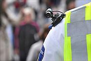 Nederland, NIjmegen, 18-7-2014Een politieman loopt met een schoudercamera, een kleine videocamera die een directe verbinding heeft met de controlekamer.Foto: Flip Franssen/Hollandse Hoogte