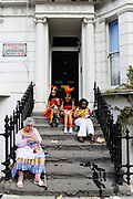 Doorstep scene at a house on the famous Ladbroke Grove. Notting Hill Carnival, London.