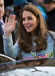© London News Pictures. 19/01/2015. London, UK. Catherine, Duchess of Cambridge waving to the crowd as she leaves after formally opening Kensington Leisure Centre in West London. Photo credit: Ben Cawthra/LNP
