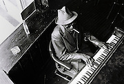 Blusman Mose Vinson plays a piano in Handy Hall, Beale Street, Memphis, Tennessee. Early 1990's. Model Release.