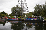Scene along the Lea Navigational Canal in East London, UK. The River Lea is a major tributary of the River Thames. Much of the Lee Navigation is within Lea Valley Park, a multi-county regional park and open space preserve.