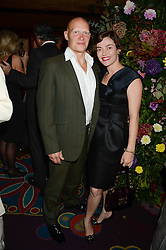 CAMILLA RUTHERFORD and DOMINIC BURNS at a 1970's themed party as part of Annabel's 50th anniversary celebrations, held at Annabel's, Berkeley Square, London on 24th September 2013.