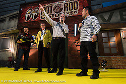 Harley-Davidson head of motorcycle design Ray Drea presents a special award of a gas tank that he hand painted for  Mooneyes owner Shige Suganuma at the Annual Mooneyes Yokohama Hot Rod and Custom Show. Japan. Sunday, December 7, 2014. Photograph ©2014 Michael Lichter.