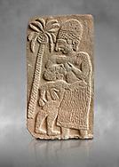 Pictures & images of the North Gate Hittite sculpture stele depicting a women breast feeding a child. 8the century BC.  Karatepe Aslantas Open-Air Museum (Karatepe-Aslantaş Açık Hava Müzesi), Osmaniye Province, Turkey. Against grey art background