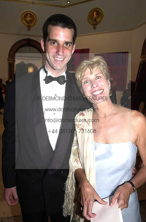 MR CLINTON EICHELBERGER and his mother MRS JOHN<br />  CLEESE, wife of the comic actor, at a dinner in London on <br /> 19th June 2000.OFL 64<br /> © Desmond O'Neill Features:- 020 8971 9600<br />    10 Victoria Mews, London.  SW18 3PY <br /> www.donfeatures.com   photos@donfeatures.com<br /> MINIMUM REPRODUCTION FEE AS AGREED.<br /> PHOTOGRAPH BY DOMINIC O'NEILL