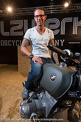 Marcus Walz had a display that showed he has completed a transition from big custom Harley cruisers to more stealth race inspired BMW customs in Hall 10 with its all custom focus at the Intermot Motorcycle Trade Fair. Cologne, Germany. Thursday October 6, 2016. Photography ©2016 Michael Lichter.