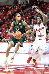 05 December 2015: Paris Lee(1) defends the encroaching Dirk Williams. Illinois State Redbirds host the University of Alabama - Birmingham Blazers at Redbird Arena in Normal Illinois (Photo by Alan Look)