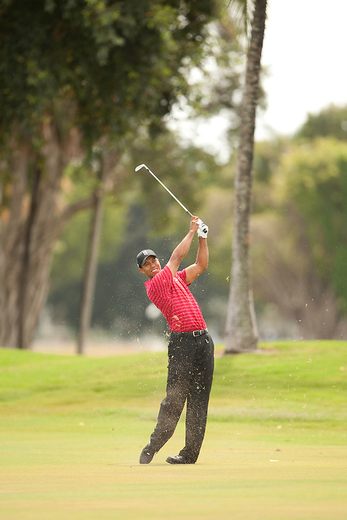 DORAL, FL - MARCH 15:  Tiger Woods hits his shot during the fourth round of the 2009 WGC-CA Championship at Doral Golf Resort and Spa in Doral, Florida on Sunday, March 15, 2009. (Photograph by Darren Carroll) *** Local Caption *** Tiger Woods