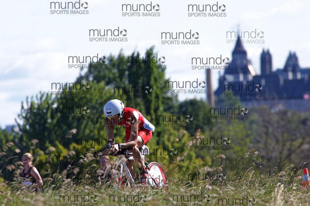 (Ottawa, Canada---10 August 2013)  Jesse  Bauer (131)  of Canada (CAN) competing in the 20-24 Male AG International Triathlon Union 2013 World Duathlon Championships (10 km run- 40 km bike- 5km run).