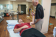 Physical Therapist Gary Costelle works with Gavin Black, a patient of Orthopedic Surgeon Nicholas Kenney, MD, photographed Friday, May 15, 2015 at Baptist Health in LaGrange, Ky. (Photo by Brian Bohannon/Videobred for Baptist Health)