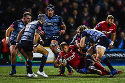 Scarlets' Tom Prydie is tackled by Cardiff Blues' Kristian Dacey - Mandatory by-line: Craig Thomas/Replay images - 31/12/2017 - RUGBY - Cardiff Arms Park - Cardiff , Wales - Blues v Scarlets - Guinness Pro 14