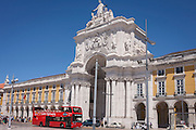 A double-decked bus with Lisbon Sightseeing company, passes the architecture of Arco Da Rua Augusto (Arch) in Praca do commercio, on 12th July 2016, in Lisbon, Portugal. These buses give tourists a fine view of many European cities. The Rua Augusta Arch is a stone, triumphal arch-like, historical building and visitor attraction in Lisbon, Portugal, built to commemorate the city's reconstruction after the 1755 earthquake. It has six columns (some 11 m high) and is adorned with statues of various historical figures. (Photo by Richard Baker / In Pictures via Getty Images)