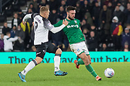 Martyn Waghorn (9) challenges Steven Fletcher (9) during the EFL Sky Bet Championship match between Derby County and Sheffield Wednesday at the Pride Park, Derby, England on 11 December 2019.