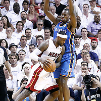 21 June 2012: Oklahoma City Thunder power forward Serge Ibaka (9) defends on Miami Heat small forward LeBron James (6) during the second quarter of Game 5 of the 2012 NBA Finals, at the AmericanAirlinesArena, Miami, Florida, USA.