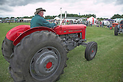 Vintage tractor display, Suffolk Smallholders annual show, Stonham Barns, Suffolk, England, July 2008. Red Massey Ferguson.
