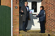 © Licensed to London News Pictures. 20/02/2013. Eastleigh, UK Boris Johnson and Maria Hutchins wait for a reply at a front door. London Mayor and member of the Conservative Party, Boris Johnson, and Conservative Candidate Maria Hutchins campaigning in the Eastleigh By-Election today 20th February in Stamford way, Eastleigh. Photo credit : Stephen Simpson/LNP