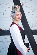 Katrin, member of the Warnemünder Trachtenverein, is wearing a traditional costume in Warnemünde, Mecklenburg-West Pomerania, Germany on March 3, 2018.<br /> <br /> Groom: Alexander<br /> <br /> The traditional costume and the bridal crown are replicas of the original costumes.<br /> People in this small fishing village were poor, so the bride did not wear a special wedding gown. She donned the gown she wore on Sundays to church and rented the bridal crown from the pastor for the day of the wedding.
