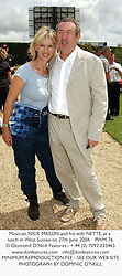 Musician NICK MASON and his wife NETTE, at a lunch in West Sussex on 27th June 2004.PWM 76