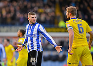 Sheffield Wednesday Forward Gary Hooper confronts Leeds United Defender Liam Cooper during the Sky Bet Championship match between Sheffield Wednesday and Leeds United at Hillsborough, Sheffield, England on 16 January 2016. Photo by Adam Rivers.
