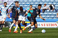 Ryan Shotton of Derby County (r) shields the ball from Ishmael Miller of Huddersfield Town. Skybet football league championship match, Huddersfield Town v Derby county at the John Smith's stadium in Huddersfield, Yorkshire on Saturday 18th April 2015.<br /> pic by Chris Stading, Andrew Orchard sports photography.