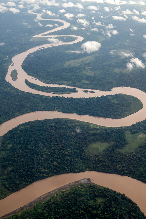 Aerial view of the Ramu River, one of the primary rivers in Papua New Guinea. The disused grass airstrip at Chungribu is visible in the upper left of the photo.<br /> <br /> (June 20, 2019)