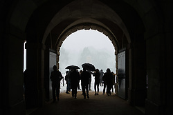 People take shelter under the archways of Horseguards Parade as a snow flurry hits Westminster. Westminster, London, February 27 2018.