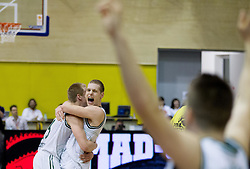 Sasu Salin and Jaka Blazic of Olimpija celebrate after winning the basketball match between KK Union Olimpija Ljubljana and KK Krka Novo mesto of finals of 11th Slovenian Spar Cup 2012, on February 19, 2012 in Sports hall Brezice,  Brezice, Slovenia. Union Olimpija defeated Krka 68-63 and became Slovenian Cup Champion 2012. (Photo By Vid Ponikvar / Sportida.com)