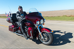 Warner Chapter American Legion Rider Ray Ireland of Aberdeen USS South Dakota submarine flag relay across South Dakota on the first day from Sturgis to Aberdeen. SD. USA. Saturday October 7, 2017. Photography ©2017 Michael Lichter.