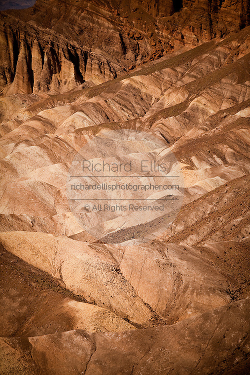 The badlands at Zabriskie Point looking toward Golden Canyon in Death Valley National Park, Nevada, USA. Zabriskie point was once the home of twenty-mule team borax mines.