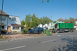 ©Licensed to London News Pictures 14/09/2020  <br /> Kidbrooke, UK. The scene of the crash at the house. A bin lorry has crashed into multiple cars and a house in Kidbrooke, South East London. A number of people have been injured police, fire and ambulance are all on scene. credit:Grant Falvey/LNP