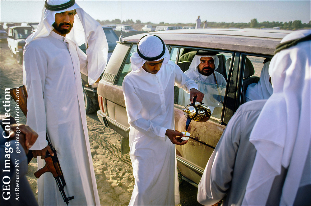 In the outback of Sharjah, one of the seven sheikhdoms that make up the United Arab Emirates, a local leader arrives in a dust-covered convoy of family members and bodyguards for races at Al Dhaid Camel Race Track.