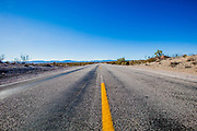 Straight endless road Through Desert photographed near Primm on the Nevada, California and Arizona state boarder