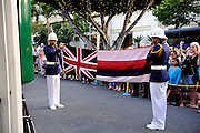 Flag lowering ceremony performed by members of the King's Village Guard of Hawaii, aka the King's Guard, a drill team that performs daily in Waikiki, Honolulu, Hawaii RIGHTS MANAGED LICENSE AVAILABLE FROM www.PhotoLibrary.com
