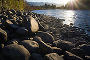 Detail of the rocky shore of the Yakima River at sunset near Cle Elum, Washington.