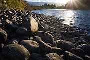Detail of the rocky shore of the Yakima River at sunset near Cle Elum, Washington.