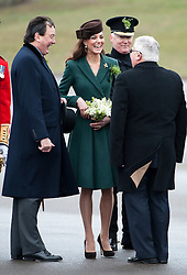 © London News Pictures. 17/03/2012. Aldershot, UK. The Duchess of Cambride CATHERINE (KATE) MIDDLETON speaking to retired member of the Irish Guards after presenting traditional sprigs of shamrock to the 1st Battalion Irish Guards at Mons Barracks in Aldershot, Hampshire, UK,  on Saint Patrick's Day, March 17th, 2012.  Photo credit : Ben Cawthra/LNP.