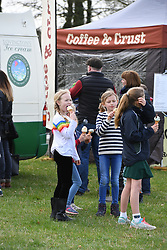 Savannah Phillips enjoying an ice cream with friends during the Land Rover Novice & Intermediate Horse Trials at Gatcombe Park on March 23, 2019.