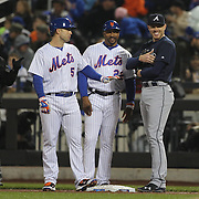 NEW YORK, NEW YORK - MAY 03:  From left, David Wright #5 of the New York Mets, First base coach Tom Goodwin #22 of the New York Mets and first baseman Freddie Freeman #5 of the Atlanta Braves in conversation during a break of play during the Atlanta Braves Vs New York Mets MLB regular season game at Citi Field on May 03, 2016 in New York City. (Photo by Tim Clayton/Corbis via Getty Images)
