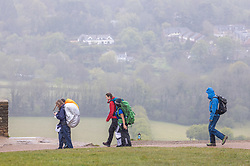Licensed to London News Pictures. 08/05/2021. Dorking, UK. A group of hikers brave the wind and rain on Box Hill, Surrey, this morning as more rain hits the South East as its revealed that May had the coldest Bank Holiday on record. However, weather forecasters predict beach and bbq weather tomorrow (Sunday) with sunshine and temperatures hitting over 20c as the miserable May weather finally starts to warm up. Photo credit: Alex Lentati/LNP
