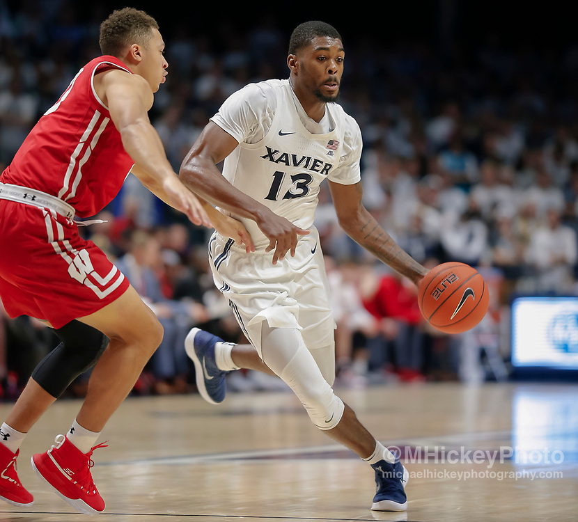 CINCINNATI, OH - NOVEMBER 13: Naji Marshall #13 of the Xavier Musketeers brings the ball up court during the game against the Wisconsin Badgers at Cintas Center on November 13, 2018 in Cincinnati, Ohio. (Photo by Michael Hickey/Getty Images) *** Local Caption *** Naji Marshall