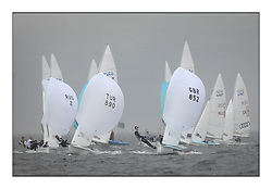 470 Class European Championships Largs - Day 1.Racing in grey and variable conditions on the Clyde..Men's Fleet on the reach in the rain with TUR890, Deniz CINAR, Ates CINAR, Istanbul Sailing Club and GBR852, Philip SPARKS, David KOHLER,  RLYC